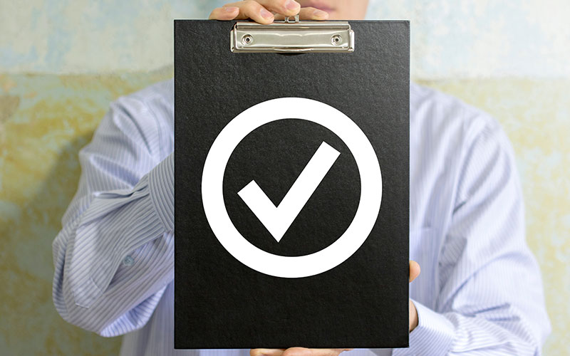 Image of a checkmark on a clipboard