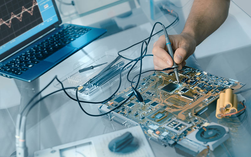 Image of hand working on circuit board