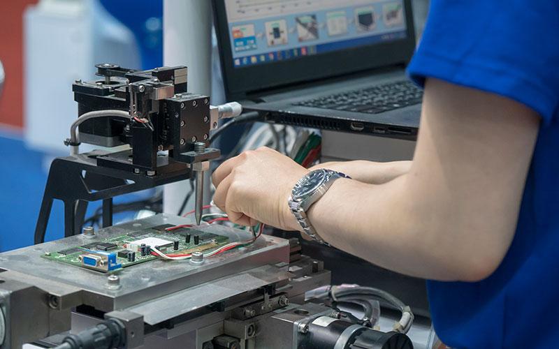 Image of engineering tweaking circuitboard